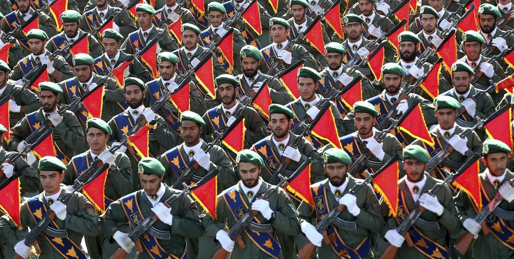 Members of the Iranian Revolutionary Guard march in a military parade in 2016 ( Image )