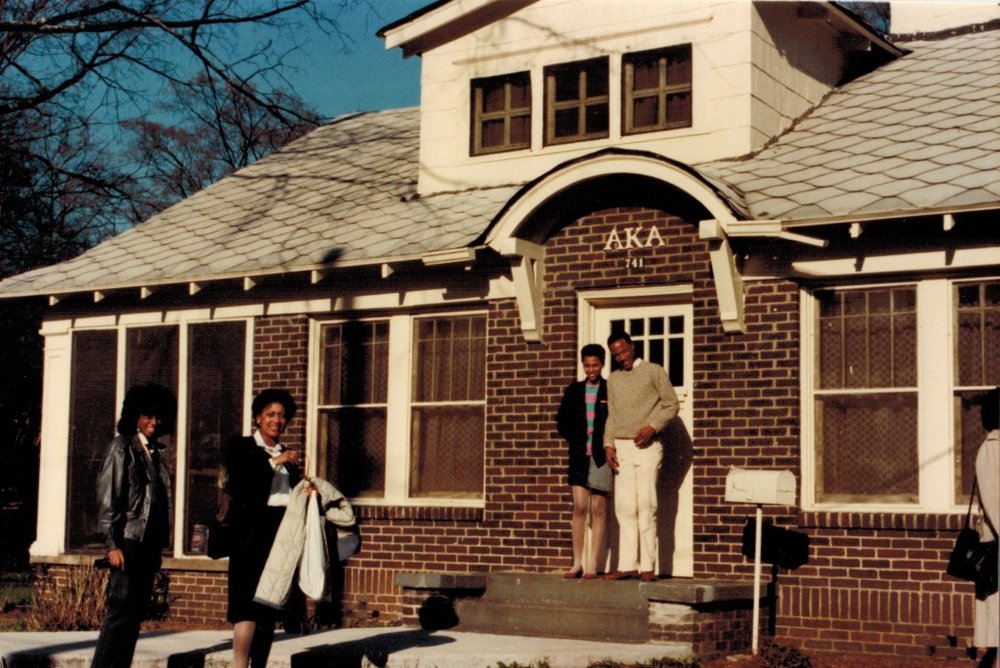 AKA house, March 1986. Gomez standing in doorway.