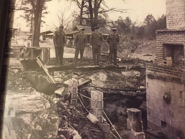 Four of Vernon Dahmer's sons, who were serving in the armed forces at the time of his murder, observe the family home burned to the ground. (Six of his seven sons served 78 years in the military). Photo by  Chris McNair , courtesy of Jerry Mitchell.