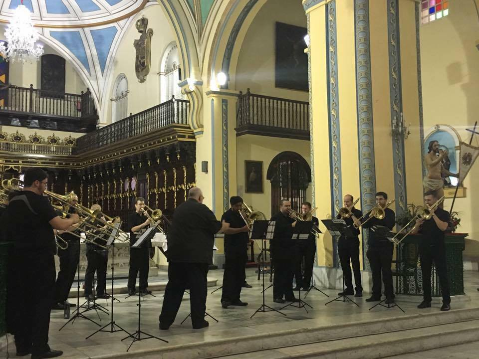 Louis Setzer (tenor trombone) and Brandon Carbonari (bass trombone) soloing in concert with the Penn State Alumni Trombone Choir in Santiago, Cuba.