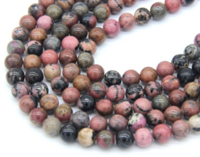 Rhodonite   Chakra: heart. An emotional balancer that nurtures love. Stimulates, clears and activates heart energy. Clears away emotional wounds and scars from the past.