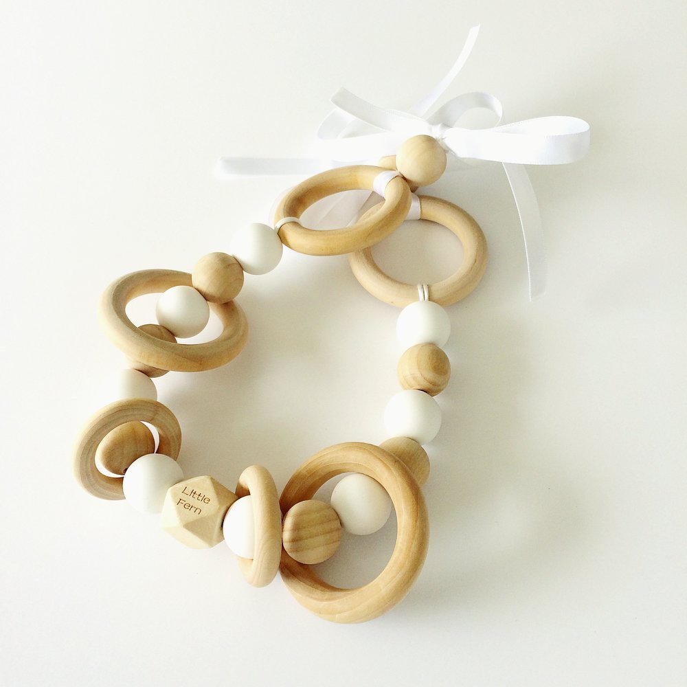 Pram Garlands - Growing Babies the Natural way.With natural wood and the gentle movement of rings, our pram garlands are perfect for little hands and minds.
