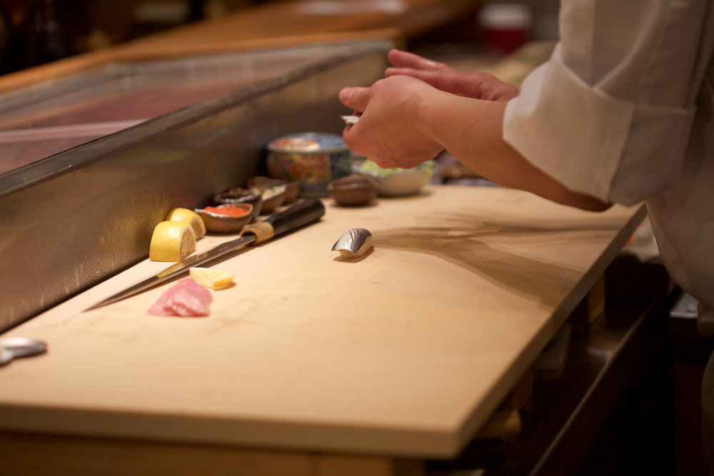 chef Tomoharu Nakamura preparing kohada