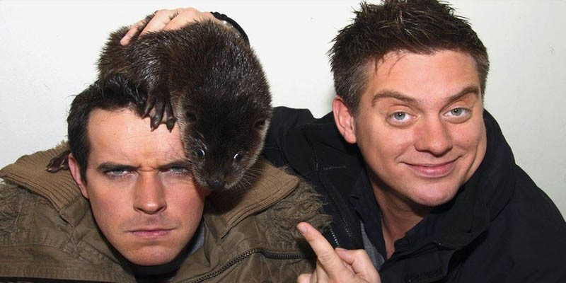Dick & Dom - the easiest way to tell them apart is remembering that Dick is always pointing to a stoat, Dom always has a stoat on his head.