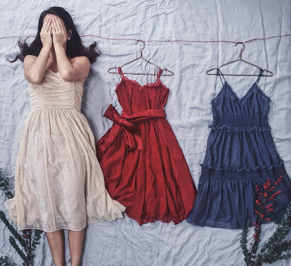 Three dresses and a girl