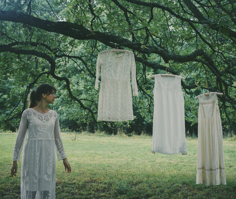 White dresses hanging in a tree