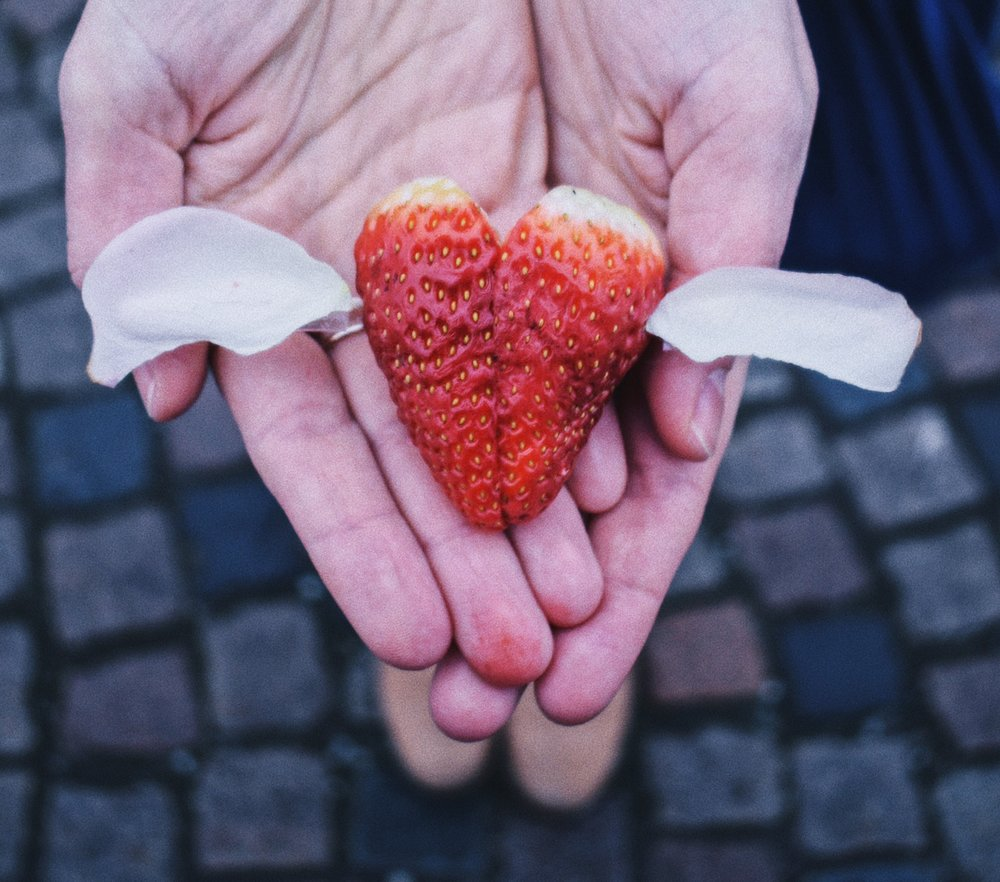 Strawberry shaped heart with wings