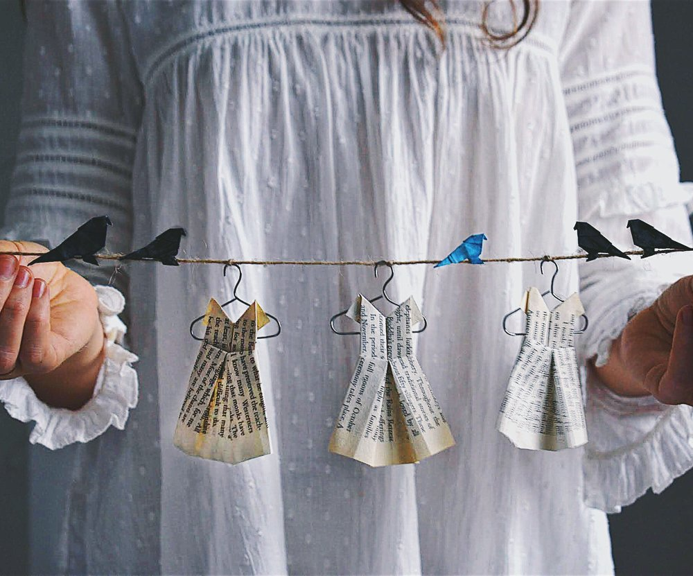 Origami dresses and birds on a string