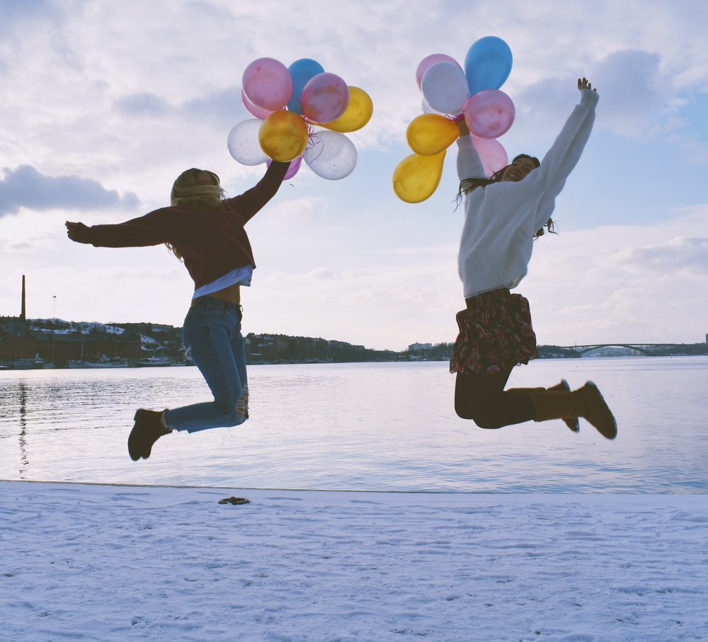 Overcoming camera shyness in public-Happy jump with balloons