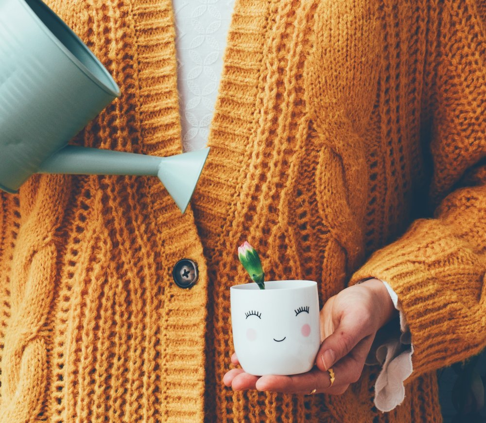 10 ways to boost creativity- yellow sweater and watering my happy plants
