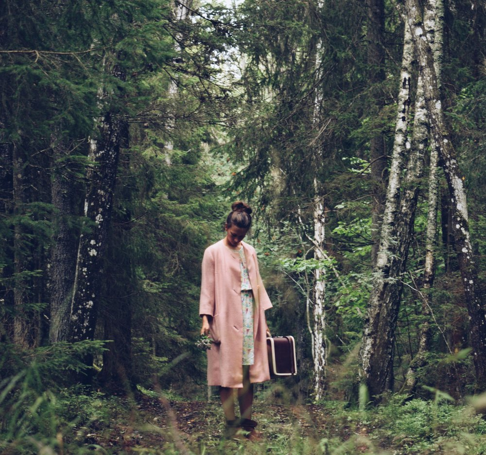 1o ways to boost your creativity- Go forest bathing, standing in the middle of the woods in my pink coat