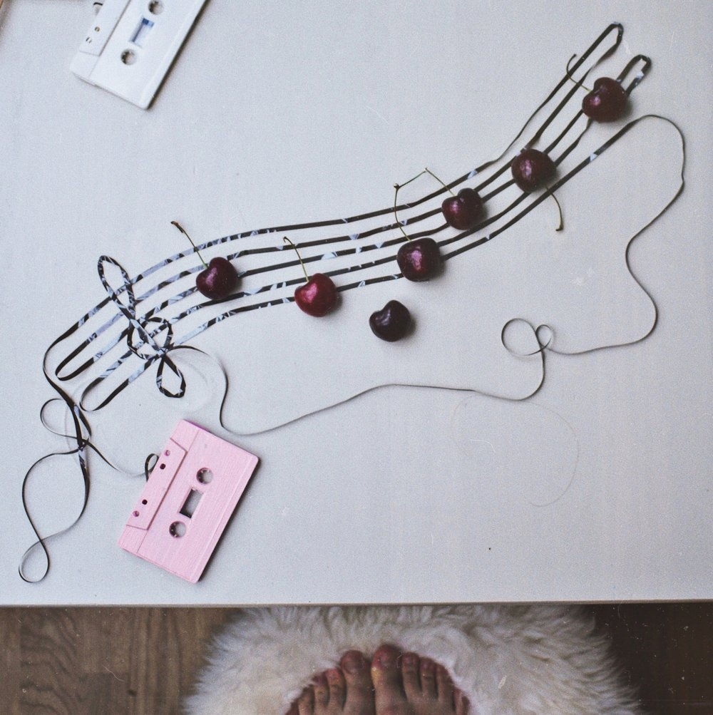 10 ways to boost your creativity- a string of notes with some cherries and a c casette