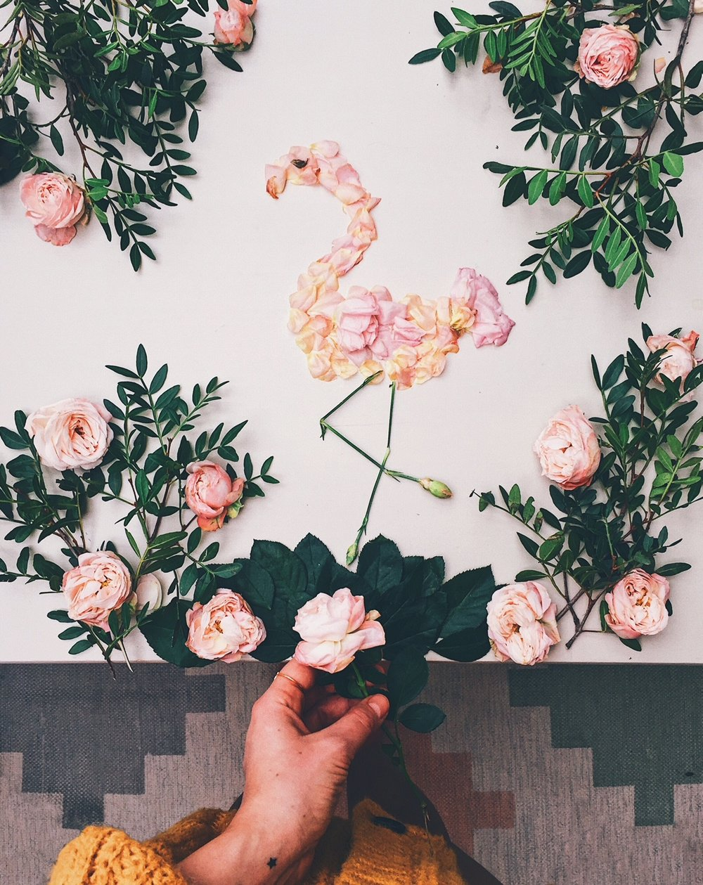 10 ways to boost your creativity- A flamingo made out of pink petals on the table