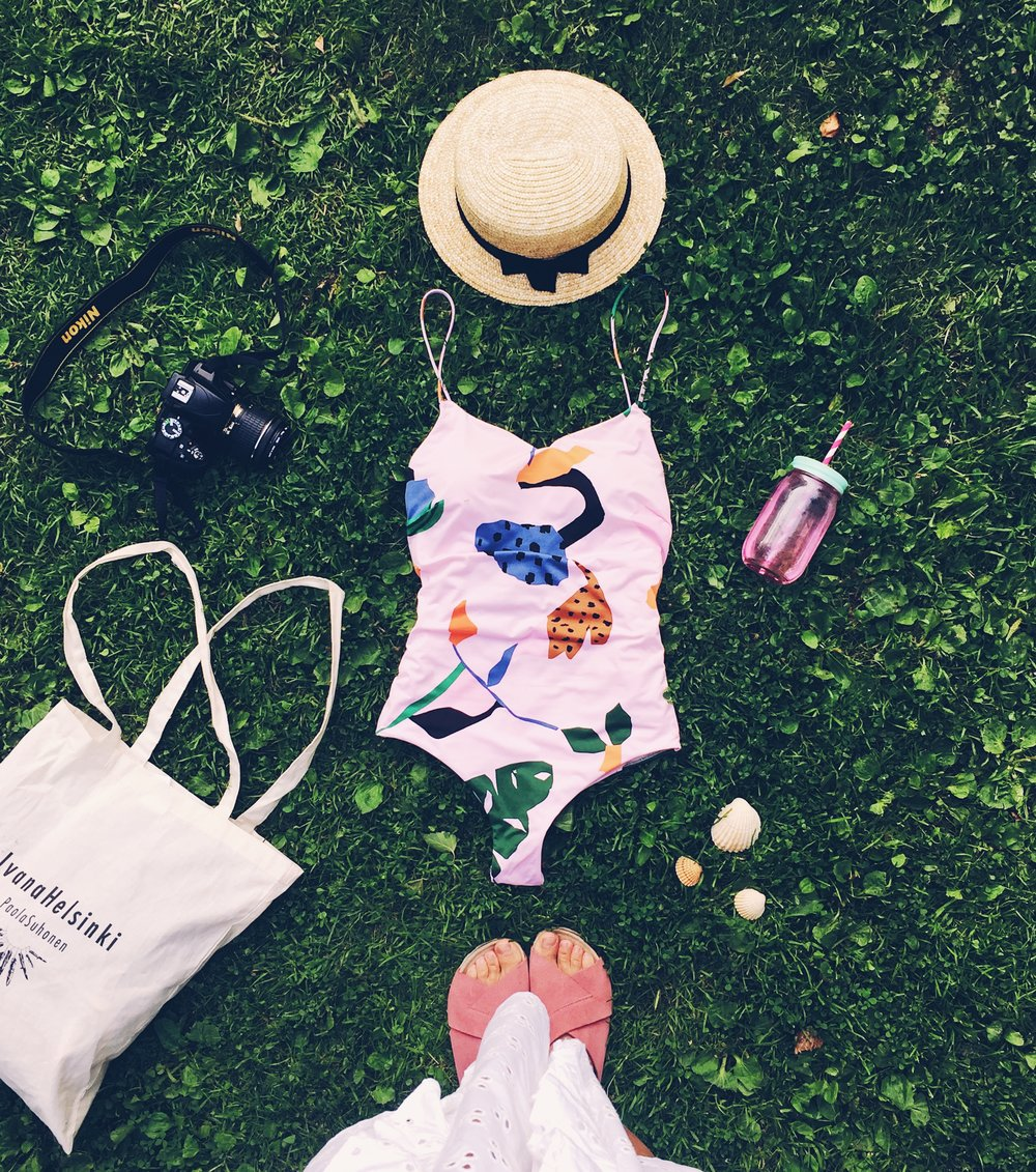 5 ways to cope with Summer restlessness- Swimsuit and sun hat on the green grass