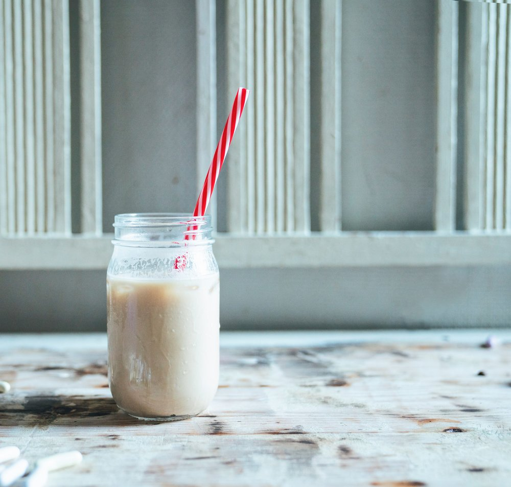 Things I'm excited about for Fall- Ice latte on shabby chic wooden table with red striped straw