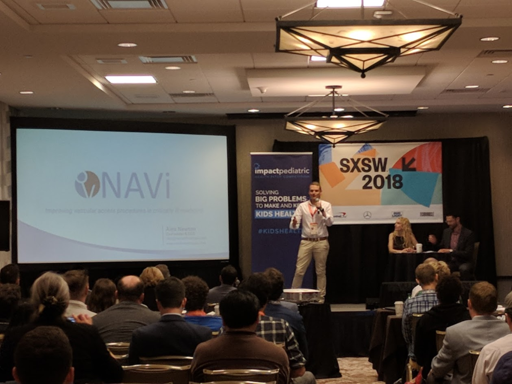 NAV CEO Alex Newton pitching the neoNAV neonatal catheter tip confirmation device at Impact Paediatric Health a SXSW 2018 in Austin, Texas.