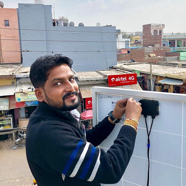 Sudheer from our operations team installs a solar panel on the roof of an Airtel store in Aligarh. People are waiting downstairs to charge phones before he has even finished. ☀️ #solarpower #phonecharger #aligarh #india #powertofhepeople #internetforall #offgrid #startuplife #nextbigthing #nextbillion #airtel #airtelindia #airteltouchinglives #india_gram #techforgood #solarenergy #solarpanels