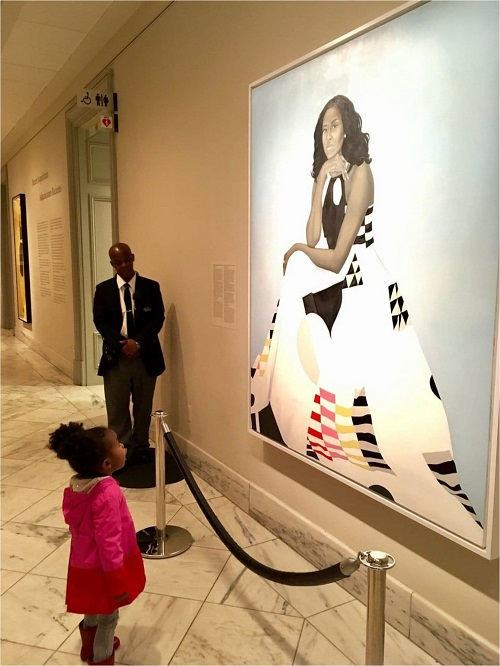 Two-year-old Parker Curry admires the portrait of Michelle Obama at the National Portrait Gallery in Washington, DC.