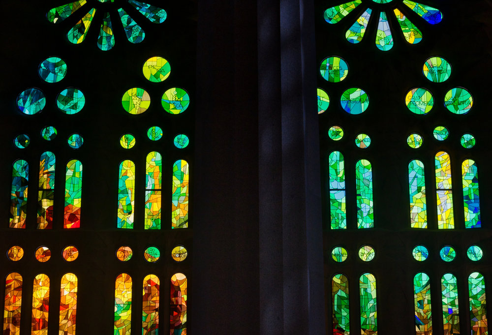 In front of some of the stained-glass windows of La Sagrada Família stands a support pillar.   Photo: Courtany Schick