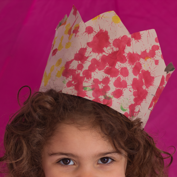 My niece wears a homemade crown while standing in her room.  Photo: Courtany Schick