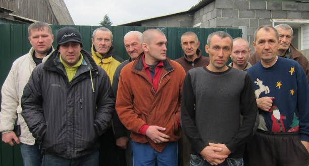 Maxim (back left) with men from the rehab center