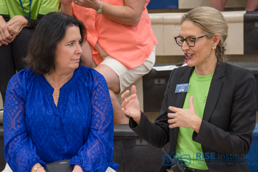 In the stands at a FIRST Tech Challenge ROBOT League meet, Florida Senator Kelli Stargel and RISE Institute Director Jennifer Canady discuss the benefits of FIRST programs for Florida students.