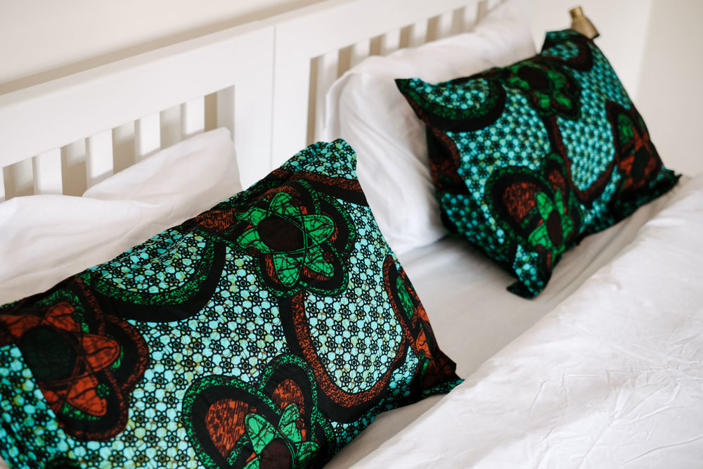 African fabrics and bright colours finish the handcrafted decor