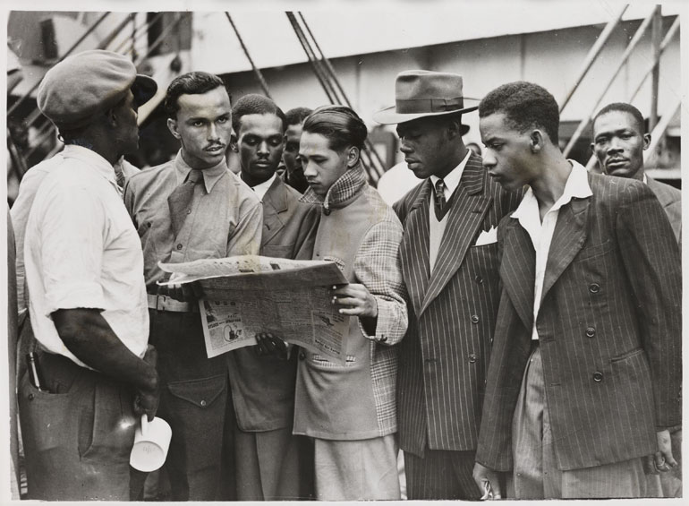 Passengers on the Windrush waiting to depart (taken from http://www.bristolreads.com/small_island_read/read_more/empire_windrush.htm)