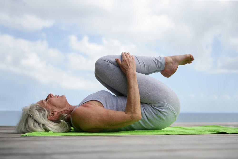 stockfresh_1896638_woman-doing-yoga-on-jetty_sizeXL.jpg
