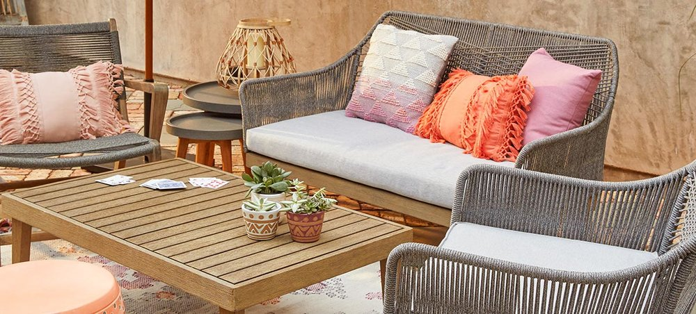 World Market has the cutest outdoor furniture of high quality and affordable prices! Add bright throw pillows during the Summer time!