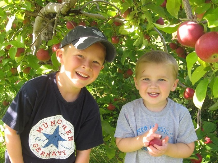 Cam and Nate enjoy a trip to the orchard in New Hampshire.  Photo courtesy of New Hampshire Hunger Solutions.