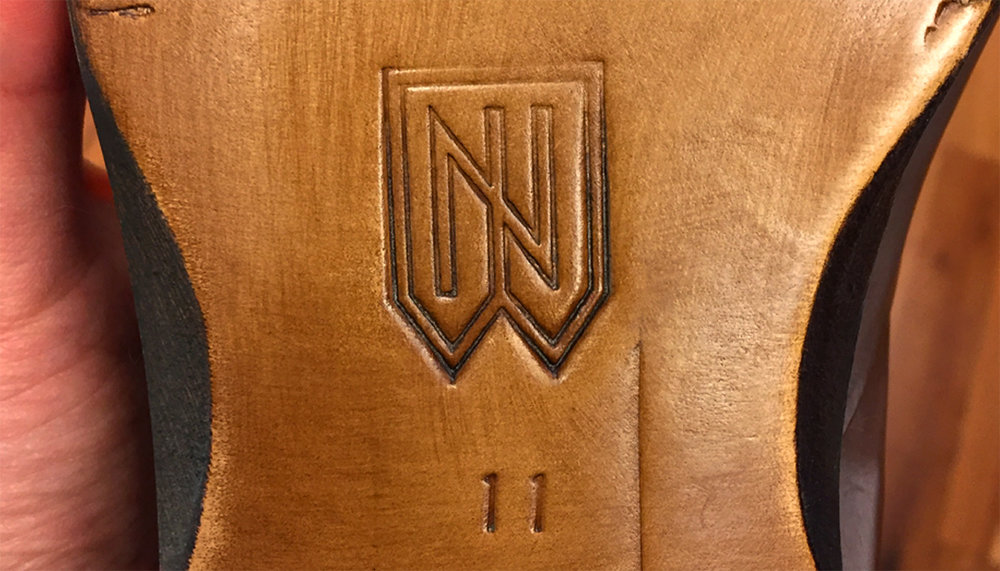 The new Noah Waxman monogram imprinted into the sole of one of his designer shoes