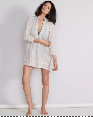 Malia Mills-The Maira Tunic  The Maira Tunic is a must have cover-up. Pack this beauty for your next day at the beach. offers a pleated v-neck and sheer look. Pair with a vibrant swimsuit underneath and a straw sun-hat and you'll be set!