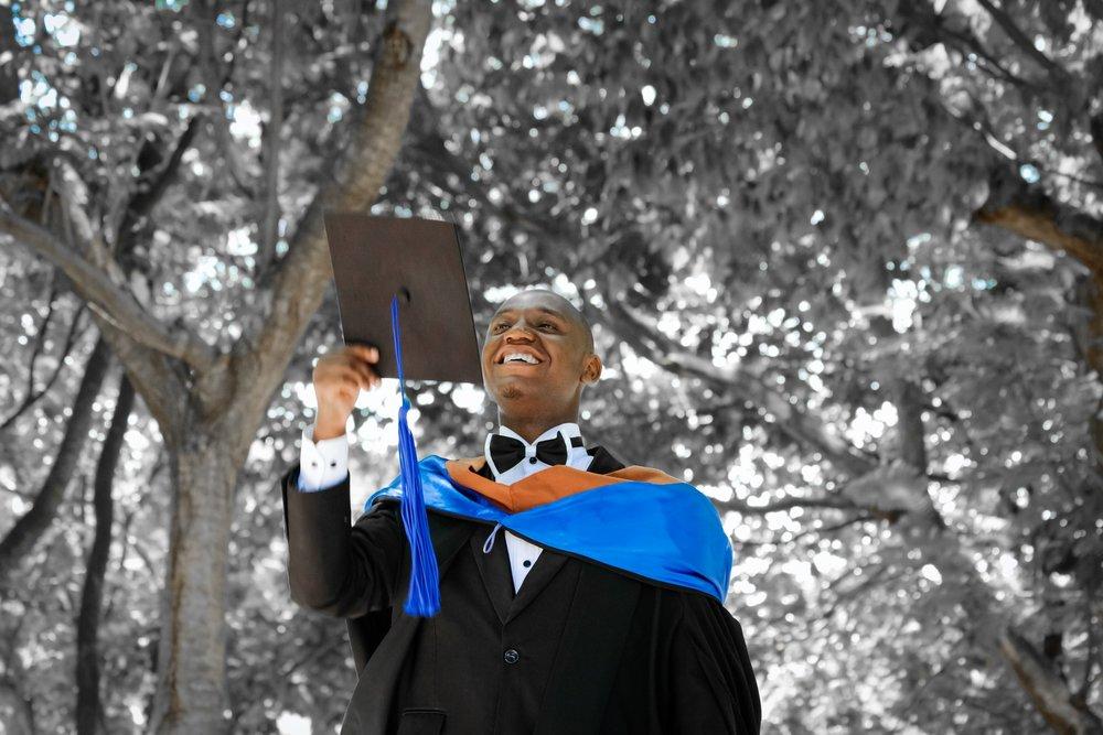 graduate with hood.jpg