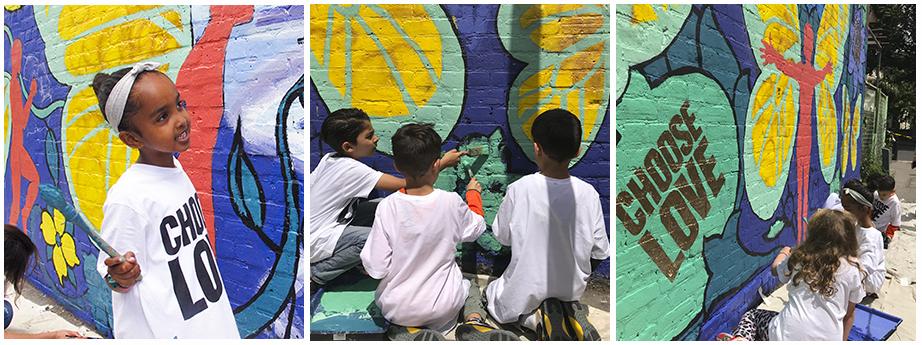 Local school children help paint the mural