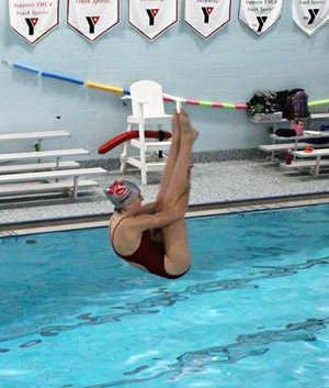 Van Wert's Madison Jarrett dives during Tuesday's dual meet against Elida and Kenton.