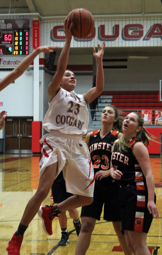 Van Wert's Caylee Phillips drives to the basket during Saturday's game against Minster. The Lady Cougars lost to the undefeated Wildcats, 60-33. Phillips led Van Wert with 11 points, including eight in the fourth quarter. The Lady Cougars (1-6) will host Wayne Trace on Saturday. Photo by Jerry Mason for the  Van Wert independent