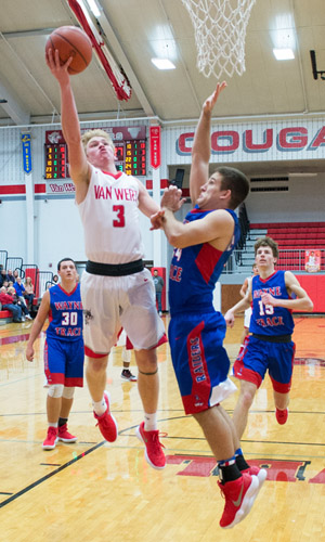 Van Wert's Nate Place drives to the basket against Wayne Trace. Place finished the game with 17 points. Bob Barnes/Van Wert independent
