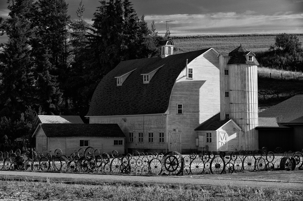 "Dahmen Barn just outside Uniontown, Washington is a haven for local artists and home to the ""folk art"" wheel fence."