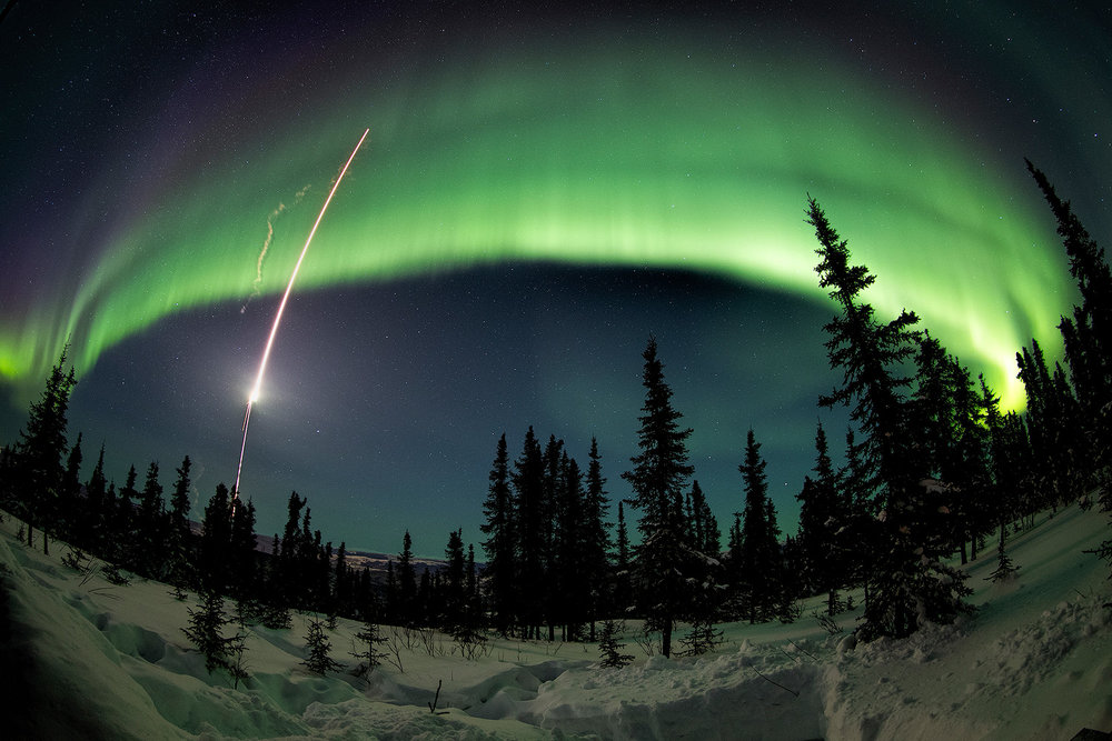 A research rocket streaks into the aurora from the Poker Flat Research Range north of Fairbanks, Alaska. If we are lucky, we may be able to witness similar launches during this aurora photography workshop.