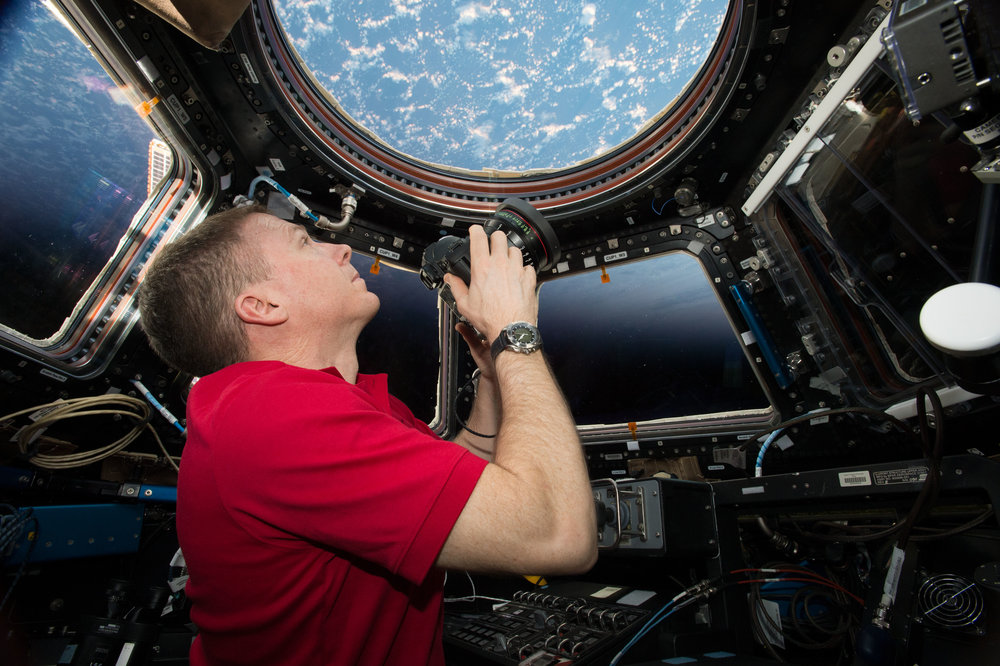Astronaut Terry Virts lines up a shot from the cupola of the International Space Station.