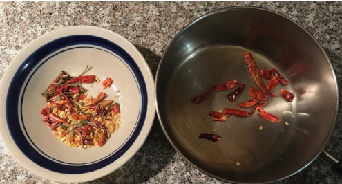 Chile De Arbol uncooked on the  left , cooked and browned on the  right.