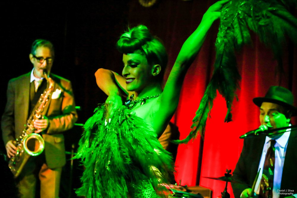 Miss Marquez - Also gracing the stage will be Miss Marquez, innovator of Cannabis themed burlesque performances, and serves as the Artistic Director of Marijuana Madness. Miss Marquez fully embraces cannabis culture with her outlandish cannabis-themed wardrobe and the billowing clouds of smoke that envelop her signature appearances around town.