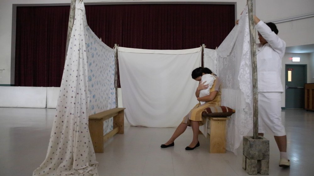 Copy of nurse touching curtain.jpg