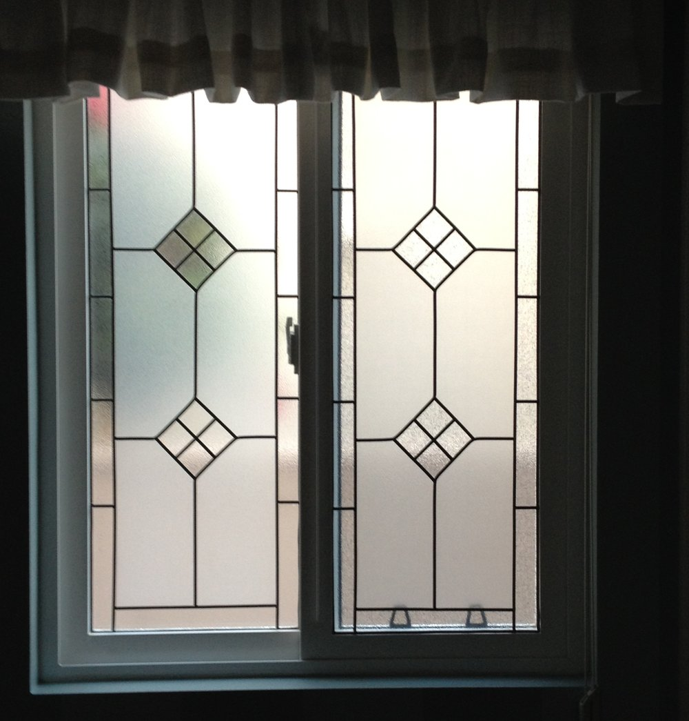 Two Leaded and Beveled Windows