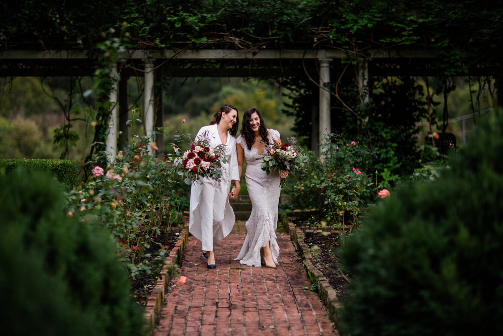 Haley and Allyson were married at J.Q. Dickenson Salt-Works in Charleston, WV. Their same-sex wedding was stunning, tasteful and totally them. I loved that even though their wedding was in October, the roses were still in bloom and we were able to get a few couples portraits in the rose garden.