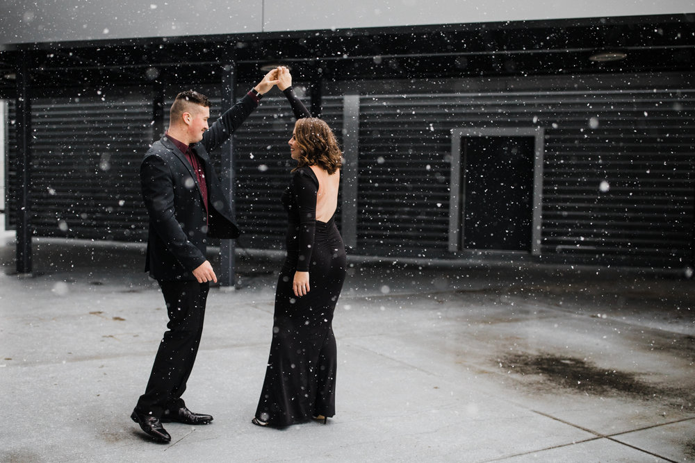 Brittany wanted an urban engagement session, which is not the easiest thing to produce in downtown Charleston, WV, but we utilized the newly renovated Civic Center and gave her a beautiful snowy photoshoot.