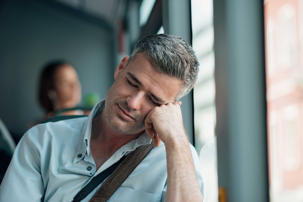 man-sleeping-on-the-bus-PSH6U4B.jpg