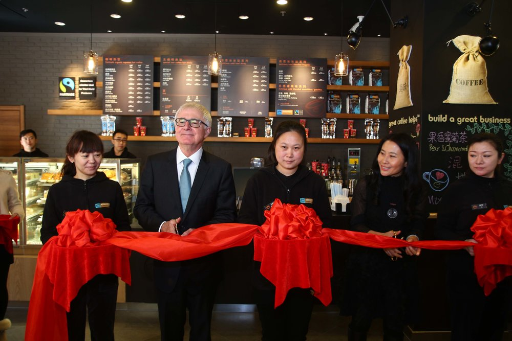 COFFEE CUT: - New Zealand Minister of Trade Tim Groser cuts the red ribbon to officially open Esquires China's 11th Beijing store. Helping him with the task is Esquires China Managing Director Ellen Zhang (second from right).  The store is Esquires China's 21st in the Peoples Republic and the second to open in Beijing's Surprise Outlets, a shopping centre of more than 35,000 sq. m. The store opening creates 12 new jobs and Esquires China master franchise owner Cooks Global Foods' (NZX:CGF) says the opening is representative of a further step in the company's growth plans for China.