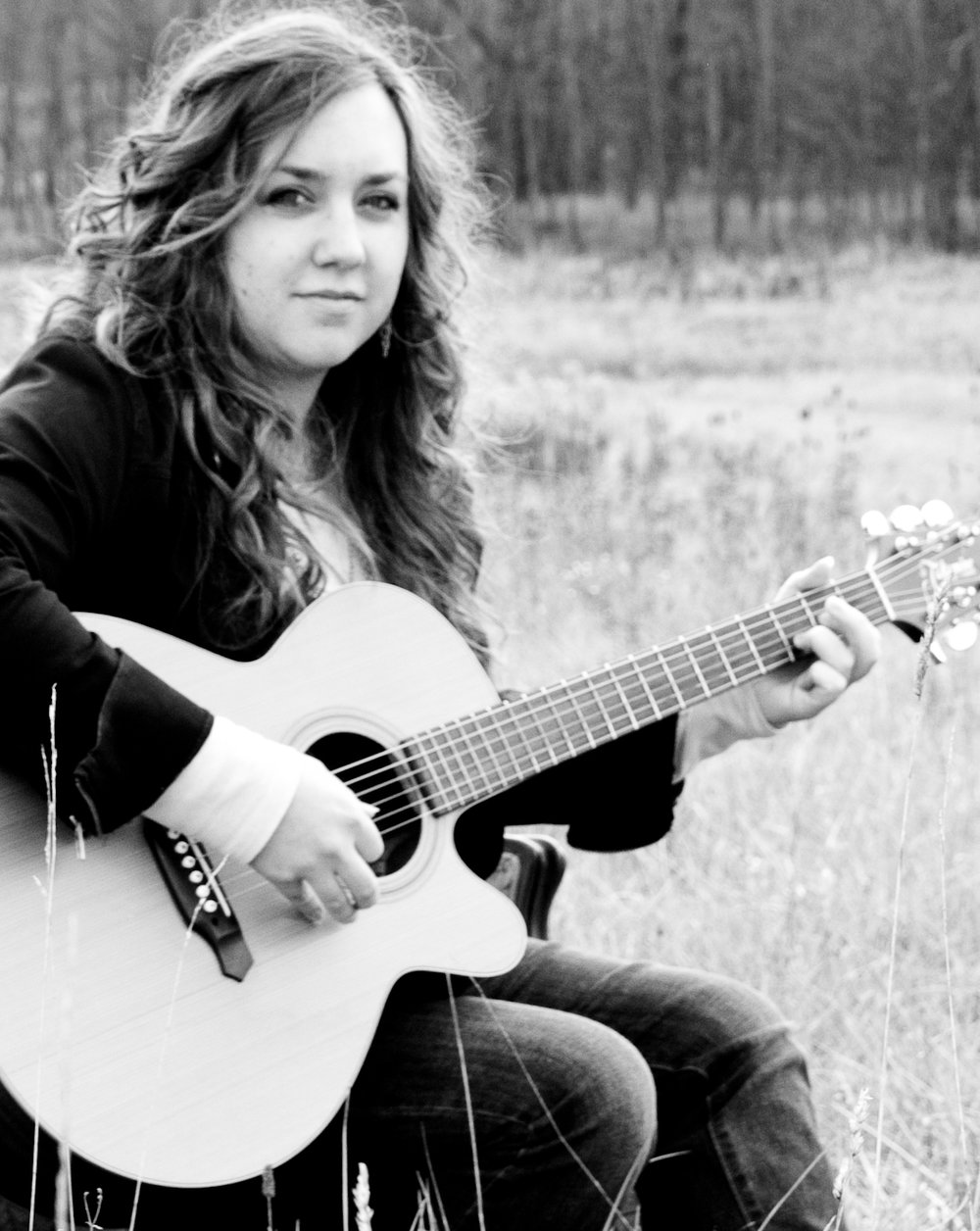 Amy Cox-guitar-field-black and white.jpg